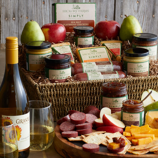 This gift basket includes all Natural Beef Sausages, Creamy Gouda, Cheddar, Sea Salt Crackers, jams and mustards, and Girasole Chardonnay