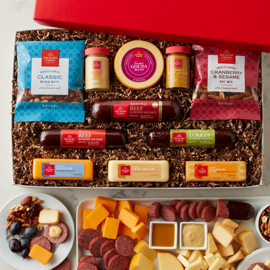 The Give Back Gift Box includes various sausage, cheeses, and nuts