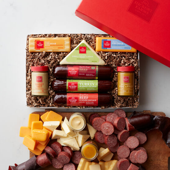Hearty Bites gift box includes sausage, cheese, mustard, and various cheeses.