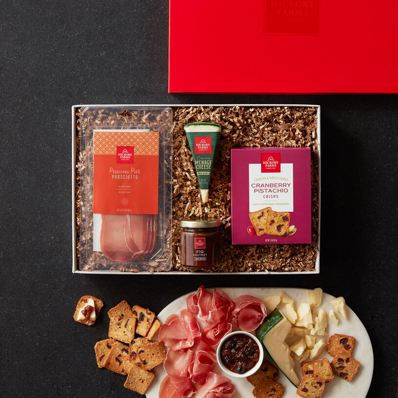It features our Premium Pork Prosciutto, Menage Cheese, Fig Chutney, and Cranberry Pistachio Crisps to stack up perfectly full-flavored bites.