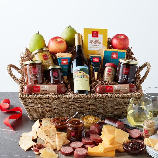 This gift basket includes all Natural Beef Sausages, Cheeses, Crackers, jams and mustards, and wine.