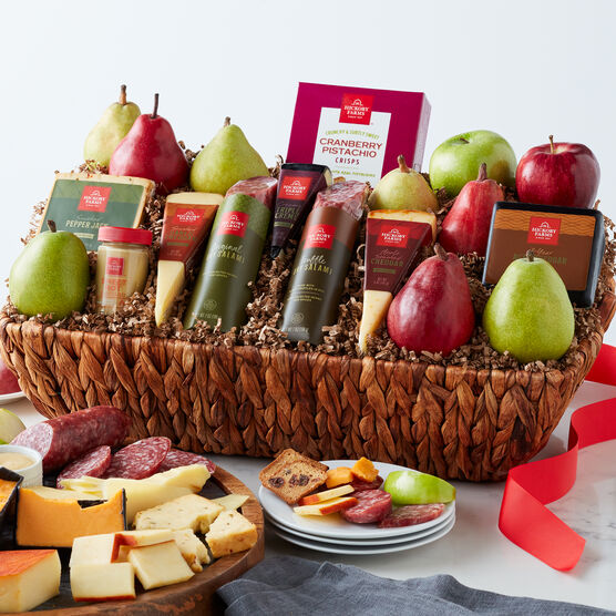The Savory Harvest Gift Basket includes pears, apples, cheese, salami, and crisps.