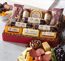 Signature Give Back Gift Box containing sausage, cheese and nuts.