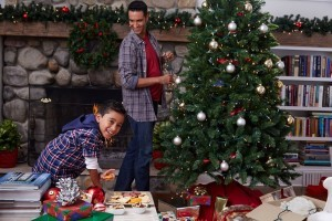 Father and son decorating tree