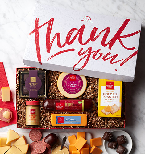 gift box with summer sausage, cheese, and mustard
