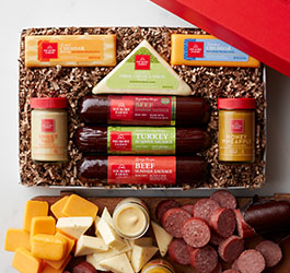 Warm & Hearty Gift Box featuring sausage, cheese, and mustards.