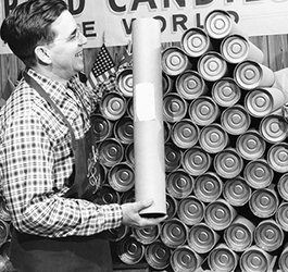 Employee stacking Beef Sticks in long containers in the 1950's.