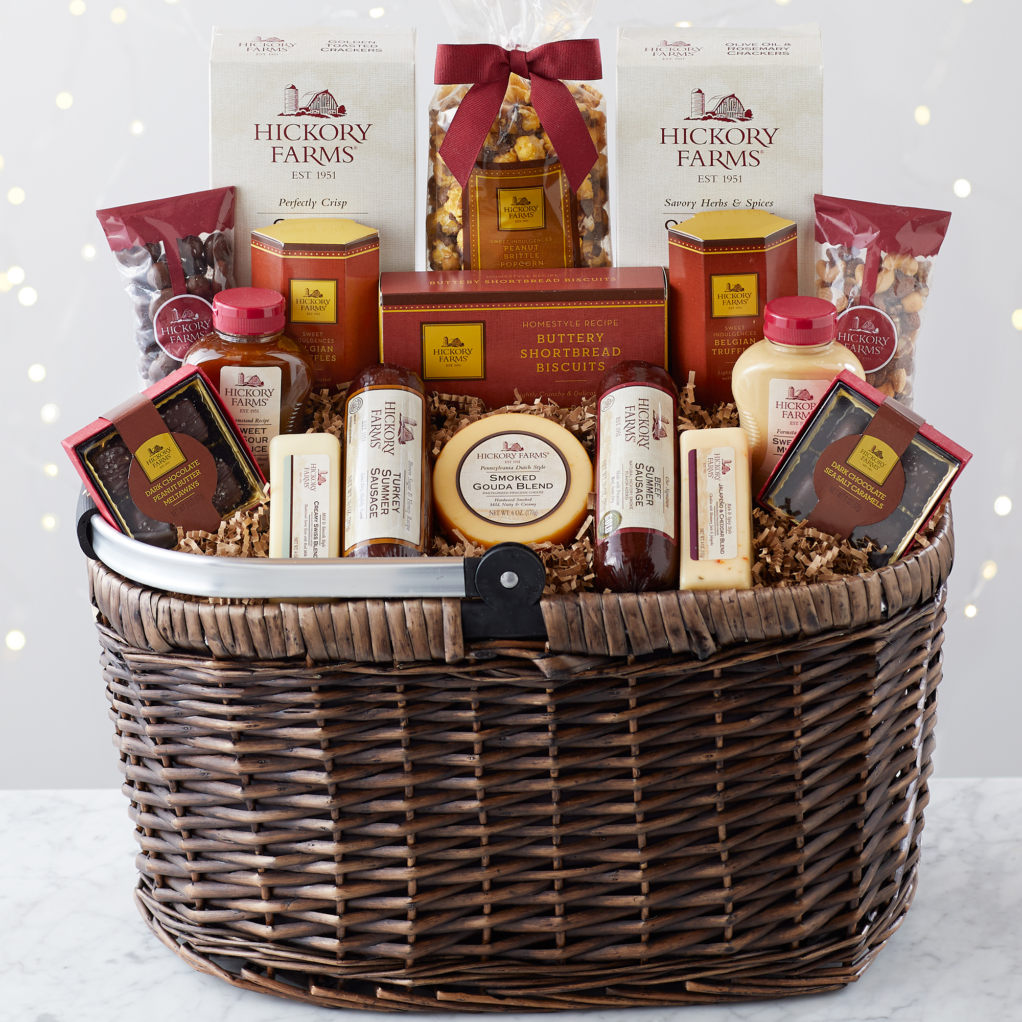 Picnic Basket includes sausage, cheese, mustard, crackers, nuts, chocolates, and · Hickory Farms ...