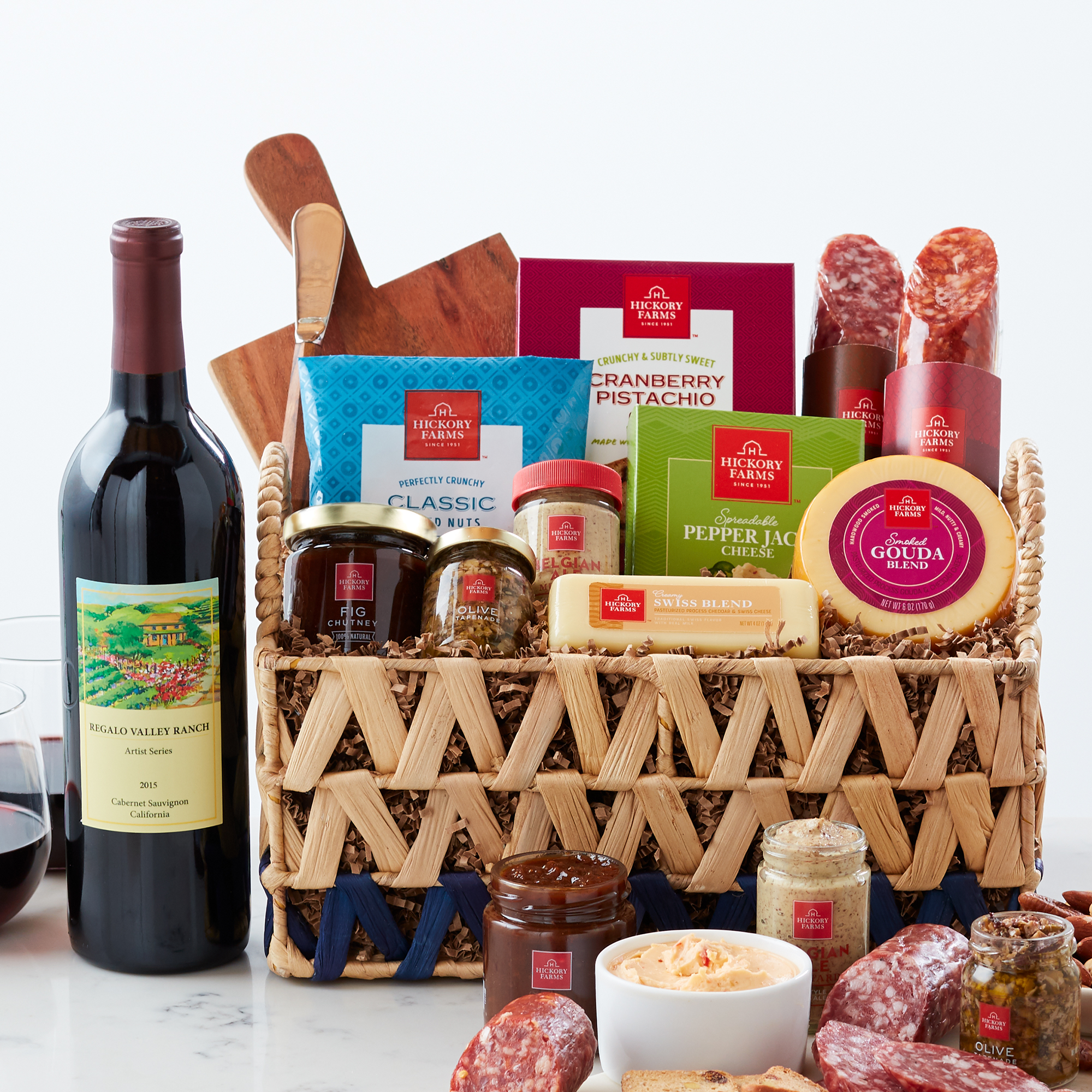 This basket is filled with savory salami, cheeses, mustard, chutney, tapenade,